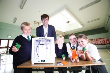 Budding engineers Matthew Thomas, Ashton Hamilton, Nicola Leacock and Eva McMurran are pictured with a character from the Pokemon video game which they made using the latest 3D printer technology.